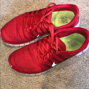All red Nike Free Run sneakers with a black swoosh
